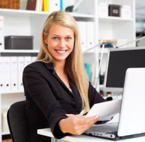 Portrait of a happy business woman working in office Emaps