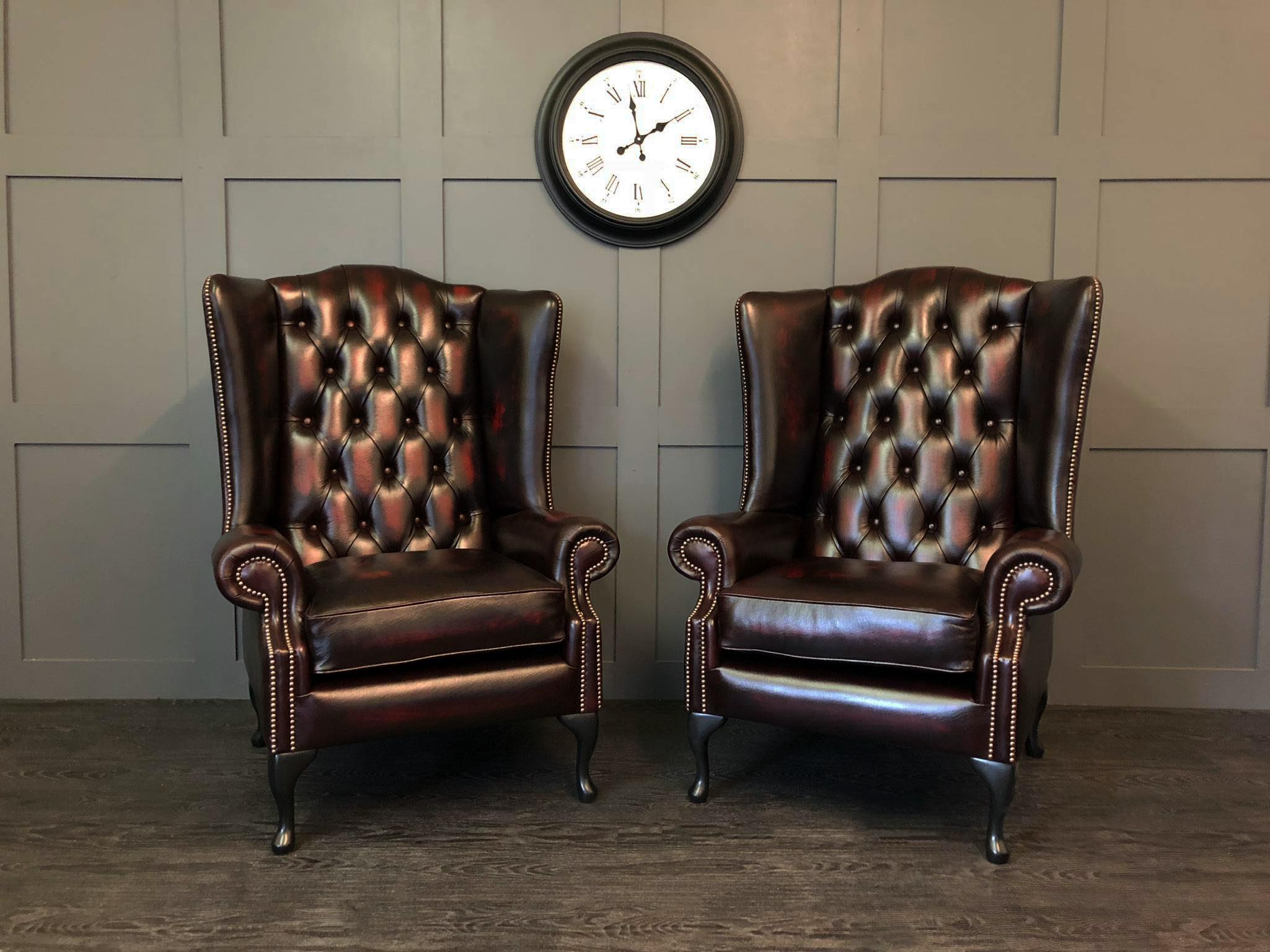 Pair of Antique Oxblood Oakley Wing chairs